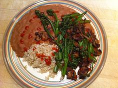 """This isn't necessarily a recipe, but it is our favorite meal. Beans, brown rice and greens (with some Sriracha sauce on top). The greens are the only part that really need a recipe: 1 onion sliced, 1/2 pound sliced mushrooms & 1 bunch broccolini. Dry sauté in a non-stick pan until browned. We like to serve them crisp-tender."" -John McDougall MD share"