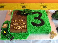 John Deere Cake with a tractor and combine. The #3 made with Oreo cookie crumbs. Rice Krispy hay bales too!