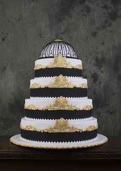 Black, white and gold Art Deco wedding cake based on Titanic interior...beautiful! Perfect for a vintage theme