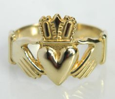 Here is a beautiful classic 14K gold Claddagh Ring. The Claddagh ring is a wonderful, iconic Irish design which represents love, loyalty and