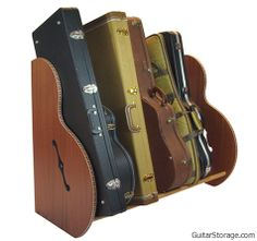 The new SPECIAL EDITION Studio™ Deluxe #guitar case #storage rack features beautiful Ribbon Striped Sapele Mahogany and Red Oak hardwood rails. product details at: http://www.guitarstorage.com/shop/mahogany-guitar-case-racks/