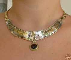 HAND MADE Necklace from Hadar Collection. 379.00$      silve plated with 24k gold, garnets.