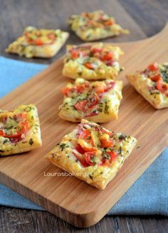 mini pizza's - ready in 30 minutes This you will need: (for 12 mini pizzas) 3 slices of puff pastry Few slices pepperoni Grated cheese Cherry Tomatoes Italian herbs beaten egg