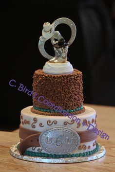 Small country western wedding cake with a fondant belt and silver fondant belt buckle by C. Bird's Coordination & Design, an OKC | Moore home bakery and coordination service.  .