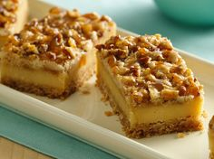 Caramel Cheesecake Bars - These bars have the best of EVERYTHING…vanilla wafers, Planters pecan, cream cheese, sour cream and drizzled with Caramel topping after chilling overnight. You will have to HIDE these but they are awesome deserts!