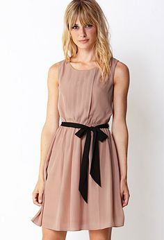 Sweet side pleated dress with black bow sash from Forever 21. Many of their dresses are rather short. So pair this dress with some lace stockings and booties and you'll be good to go.