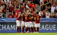 Alessandro Florenzi #24 with his teammates of AS Roma celebrates after scoring the team's first goal during the UEFA Champions League Group E match between AS Roma and FC Barcelona at Stadio Olimpico on September 16, 2015 in Rome, Italy.