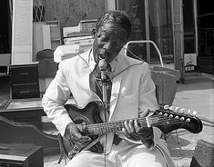 Maxwell Street Jimmy -- 1977  When Jimmy Davis settled in Chicago, he made Maxwell Street his home. Maxwell Street Jimmy is the only musician who lived on Maxwell Street and owned a business there, The Knotty Pine Cafe.