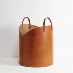 Tan Leather Log Basket Tan Leather Log Basket by Otis Ingrams, a large storage b., Tan Leather Log Basket Tan Leather Log Basket by Otis Ingrams, a large storage basket made from two large sheets of leather with a wooden base. Leather Accessories, Leather Jewelry, Leather Purses, Leather Totes, Leather Bags, Leather Gifts, Leather Craft, Deco Cuir, Large Storage Baskets
