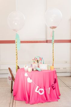 whimsical wedding sweetheart table, oversized balloons wedding, confetti balloon wedding, love banner wedding from colorful confetti wedding at DC Eastern Market North Hall wedding