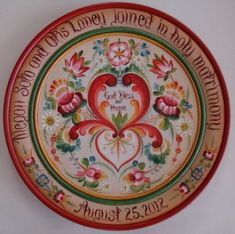 Os Style Wedding Plate .... I have seen wooden plates which have been painted, and perhaps this is one of those.