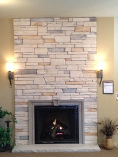 Stack Stone. Fireplace. home improvement.  Love the lighter stone.  autumnglo.com
