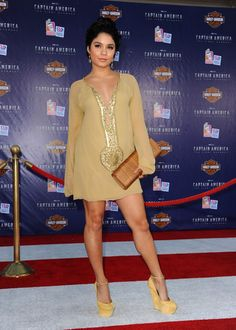Vanessa Hudgens Wedges Vanessa Hudgens ofset the bohemian vibe of her chiffon mini dress with matching camel suede platform wedges.  Brand: Giuseppe Zanotti Vanessa Hudgens Beaded Dress Vanessa Hudgens worked her new pixie cut at the Captain America premiere! The glowing actress opted for a chiffon tunic dress with an Indian influence. A beaded neckline and center front design made the number dazzle. Brand: Farah Khan