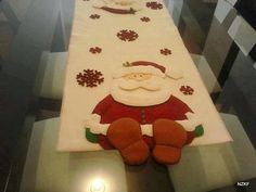 Santa table runner feet hang over Christmas Sewing, Felt Christmas, Christmas Projects, Holiday Crafts, Christmas Time, Christmas Ornaments, Christmas Door, Table Runner And Placemats, 242