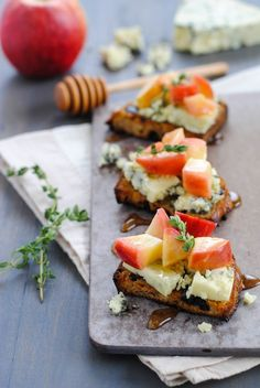 Raisin Crostini with Blue Cheese & Apples - Sweet, savory and cheesy. A pretty party bite that is a cinch to pull together!