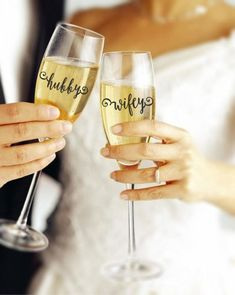 Hubby and Wifey Champange Flutes: Make the most out of your champagne toast with these newlywed flutes. They'll look cute in photos and make for a sentimental souvenir long past your wedding night.