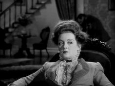 """Bette at her hard-hearted best! In this pivotal scene from """"The Little Foxes"""", directed by William Wyler, Herbert Marshall discovers the downside of discussing his will with his ambitious wife..."""