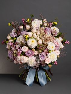 Dusky Skies Bouquet This palest pink bouquet, inspired by the evening sky, is comprised of pale pink dahlia, ocean song roses, bombastic roses, pink snowberries, pale pink hydrangea, pink astrantia and accented with mimosa foliage. From £75 http://wildatheart.com/seasonal-favourites/dusky-skies-bouquet.html
