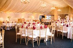 The reception in the Lakeside Pavilion with its elegant, linen-draped ceiling and walls is opulently decked out in gold, ivory, and red | Stonegate Conference and Banquet Centre | Jordan Imhoff Photography