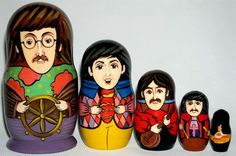 John Lennon is the main doll with Paul McCartney, George Harrison and Ringo Starr following along.
