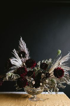 A Dark & Moody Halloween Centerpiece DIY for a grown up or adult dinner party for Halloween or Thanksgiving, made with pampas grass, burgundy dahlias, poppy pods and more. Halloween Flowers, Diy Halloween, Halloween Decorations, Halloween Flower Arrangements, Dark Flowers, Dried Flowers, Floral Centerpieces, Wedding Centerpieces, Floral Arrangements