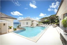 Sunrise House is a spectacular hillside villa a short stroll from the famous Macaroni Beach in the beautiful Caribbean island of Mustique.