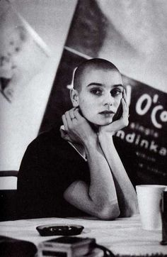 """Give it up for adorable Irish singer songwriter Sinéad O'Connor. Her 1990 album ""I Do Not Want What I Haven't Got"" was a revelation. The skin headed protest singer landed a worldwide hit. Pretty People, Beautiful People, Photo Star, Skin Head, Irish Singers, Bald Girl, Bald Women, Shaved Head, Portraits"