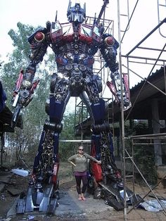 Mind = Blown! Holy wow! The woman pictured in the shot built this Transformer statue! Again. Wow!