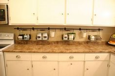 The newly uncluttered kitchen counter. IKEA has the Fintorp rails and baskets. Kitchen Hacks, Diy Kitchen, Kitchen Dining, Kitchen Decor, Kitchen Ideas, Kitchen Planning, Kitchen Magic, Condo Kitchen, Kitchen Counters