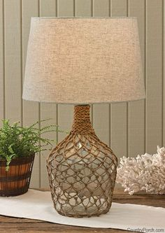 Sea Bottle Jug Lamp with Shade, by Park Designs. This nautical inspired sea bottle jug lamp features a jute fishing net overlay. Measures x 9 inches. Use with up to a 100 watt bulb (not included). Glass Bottle Crafts, Wine Bottle Art, Macrame Design, Bottle Lights, Diy Home Crafts, Table Lamp, Home Decor, Painted Tables, Painted Chairs