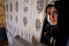 Syrian refugee girl in tent in Jordan Valley