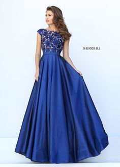 Bright and breezy, the Sherri Hill 50346 full-length, royal blue prom dress encapsulates the joy of the evening.
