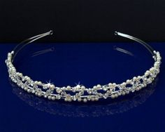 """SC Bridal Wedding Tiara Headband With Pearls and Crystals 55916 by SparklyCrystal. $16.99. The SPARKLYCRYSTAL hairband comes in a keepsake presentation round clear plastic box. It's a great display for your precious tiara and to keep your pleasant memory forever.. Measures approximately 3/8"""" tall at the center.. Pin loops at each end that allow you to fasten it in your hair with bobby pins.. Made with high quality clear Austrian crystals in silver plated metal setting.. T..."""