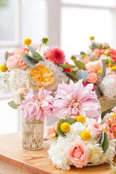 Pink dahlias, peach garden roses, billy buttons, and hydrangeas | Photo by Amanda Hein | Floral design by Fleur