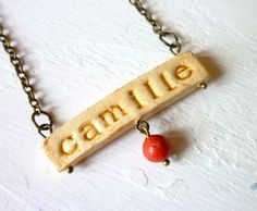 Personalized air-dry clay necklace. Think of the possibilities!