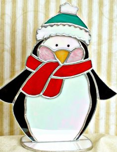 Adorable stained glass penguin is dressed for the by ClearerImage