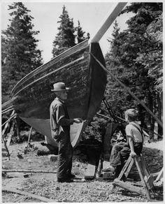 Cape Breton fisherman and newly built boat, Cape Breton Highlands National Park, Nova Scotia.