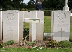 An unknown French soldier grave is flanked by two Canadian tombstones at the Canadian War Cemetery near Dieppe, France, 18 August 2013, on the eve of the 71st anniversary of the Dieppe raid. More than 6000 allied troops, mostly Canadians, landed on 19 August 1942. At the end of the day, after a fierce battle, the Allies had 1550 dead and some 2400 prisoners. Dieppe's citizens and guests read the names of the 948 Commonwealth servicemen of WWII who are buried or commemorated in this cemetery.