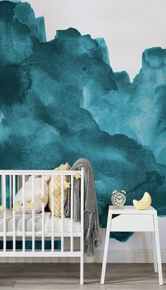 Stylish watercolours for your little one's room. Sumptuously rich teal textures come together in watercolour wallpaper design. Pair with bright yellow accents to offset the blue for a cool, modern feel. Perfect for children's bedrooms and play spaces.