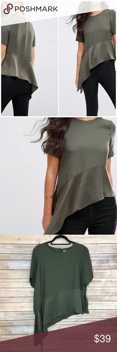 "NWOT Asos Matte & Shine Top Soft woven fabric Crew neckline Peplum design Asymmetric hem Button-keyhole back Regular fit - true to size Pit to pit 23""/ length 24"" and 30"" 100% Polyester ASOS Tops"