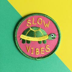 Its not all about living life is the fast lane, this guy is here to remind us that slow and steady can win the race! This cute Slow Vibes tortoise patch is a really vibrant and pleasing combination of pink, green and yellow. The cute little tortoise has a bit of a confused expression which we think makes him even more adorable! A perfect easy iron on to decorate your clothes or bag.  This is quite a large patch, measuring 7cm (2.75) across…