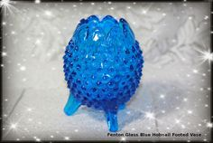 Fenton Glass Blue Hobnail Footed Egg Vase. Starting at $25