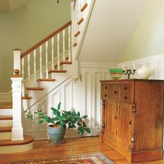 Removing this foyer's dividing wall, the downstairs bath and its closet, opened up the first floor for better light, flow and a dramatic entry. | Photo: Deborah Whitlaw Llewellyn | thisoldhouse.com