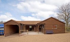 Find your perfect equestrian building. This U-shaped building with two stables and oak posts was designed and built by The Stable Company for a client in Worcestershire. Shed Floor Plans, Free Shed Plans, Horse Barn Plans, Horse Barns, 12x24 Shed, U Shaped Houses, Backyard Barn, Loafing Shed, Farm Layout