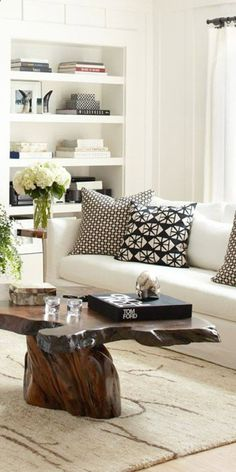 Loving this modern black  white living room with rustic wood coffee table and drum pendant lighting