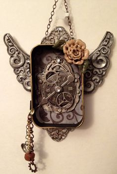 Steampunk Altoid Tin Shrine with Steampunk Clock, Wings and embellishments. $20.00, via Etsy.