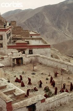 Monks Chanting in Gandan Monastery Courtyard - Monks chant in the remains of the courtyard of Gandan Monastery, decimated by the Chinese during the Cultural Revolution. Tibet - Dean Conger