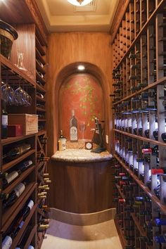 Traditional Wine Cellar with flush light, limestone tile floors, High ceiling