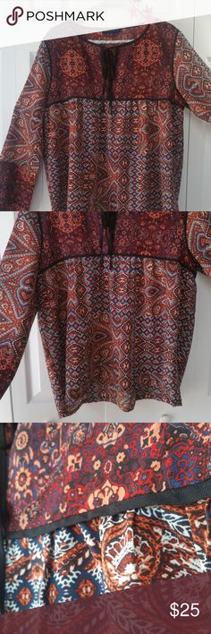 """🏵️NWOT Sanctuary 🌿""""Patwork Belle"""" Boho Size M🌿 Amazing, lightweight blouse from Sanctuary! A beautiful Boho peasant top that feels super soft and flows in the breeze💃. It is a wine🍷 multicolor long sleeve top with an intricate, stunning design🤩. A cute V-neck with long ties that look good done up or left loose. Perfect for nearly any season, this top is in PERFECT condition (I have a bad habit of removing my tags 😐) and in need of a loving home!  💯% Polyester MSRP $89 P.S. VERY…"""