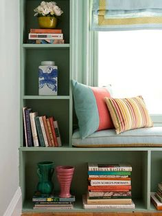 Built-in bookcases framing a window seat are ideal for displaying favorite reads and decorative items.